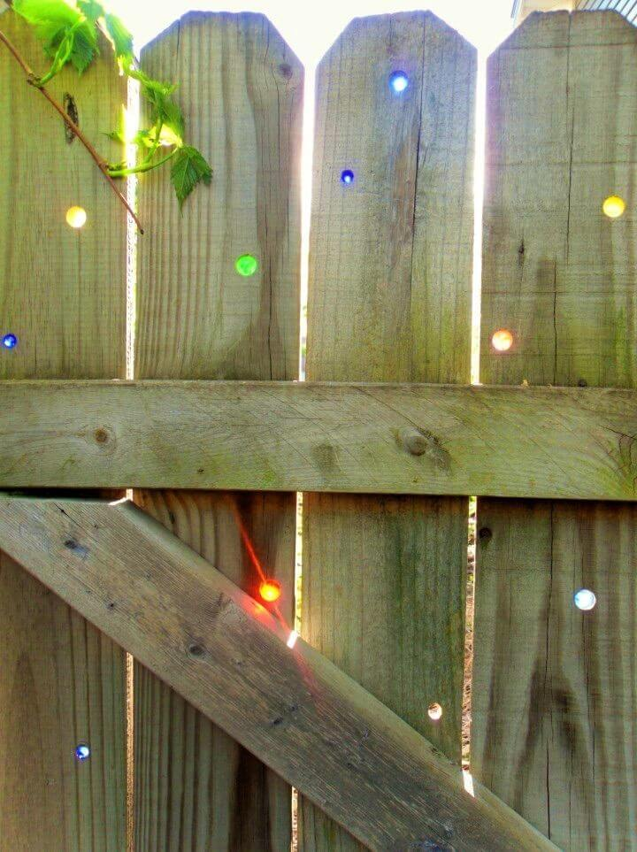 Cheap DIY Glass Marbles In Your Fence