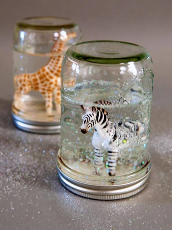 Make Glitter Snow Globes from Mason Jars