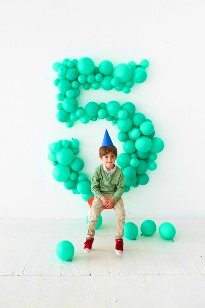 Pretty DIY Giant Balloon Number Backdrop