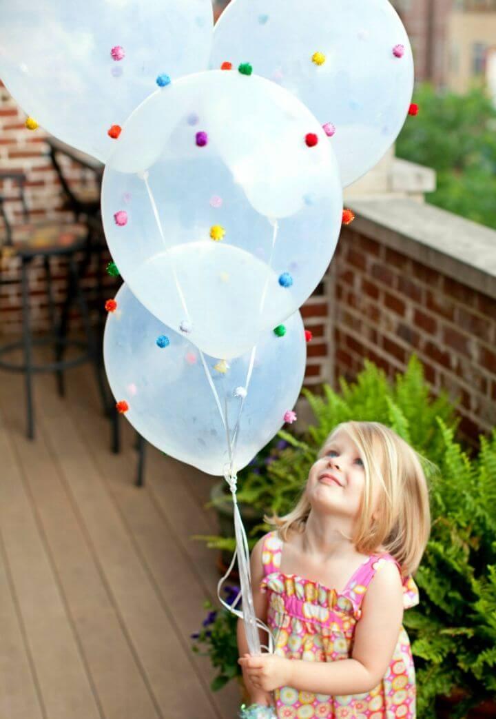 Pretty DIY Pom pom Balloons